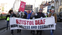 LS_BSL_March_Road_Colston_Ave_protesters_walking_long_banner