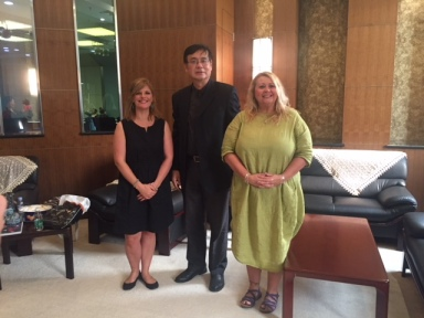 With director of shanghai deaf association as well as deputy director of China deaf association